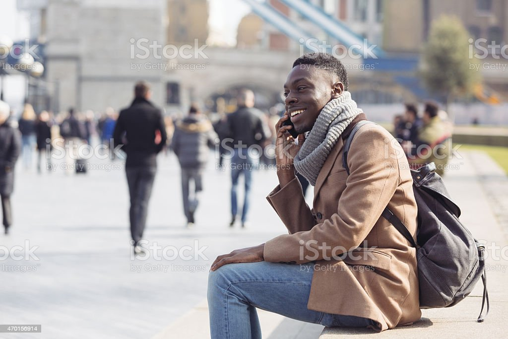 Black man talking on mobile phone in London stock photo