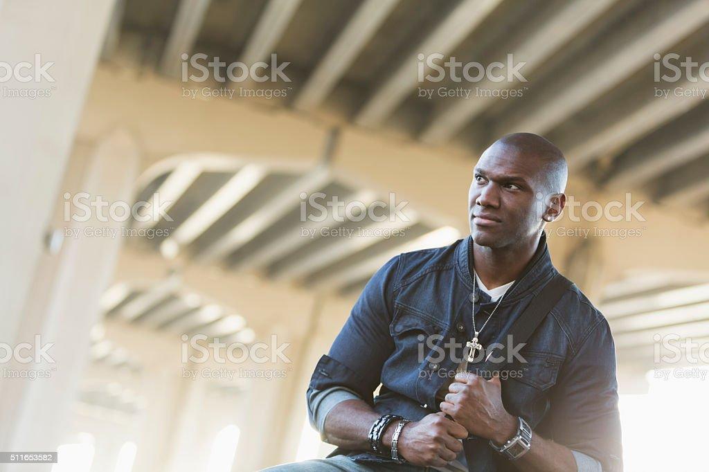 Black man wearing jewelry and denim stock photo