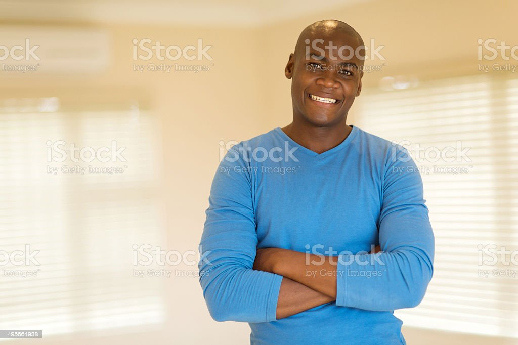 black man with arms folded stock photo