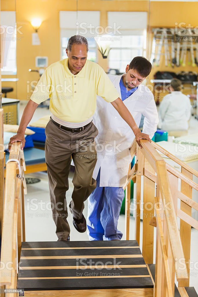 Black man with physical therapist, gait training stock photo