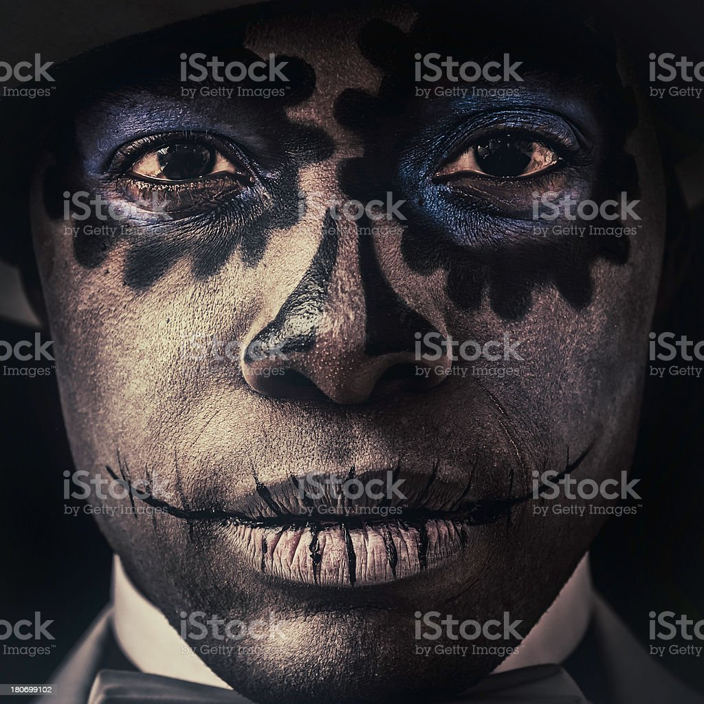 Black man with Sugar Skull makeup on his face (VII) stock photo
