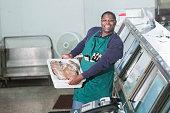 Black man working in a fish market