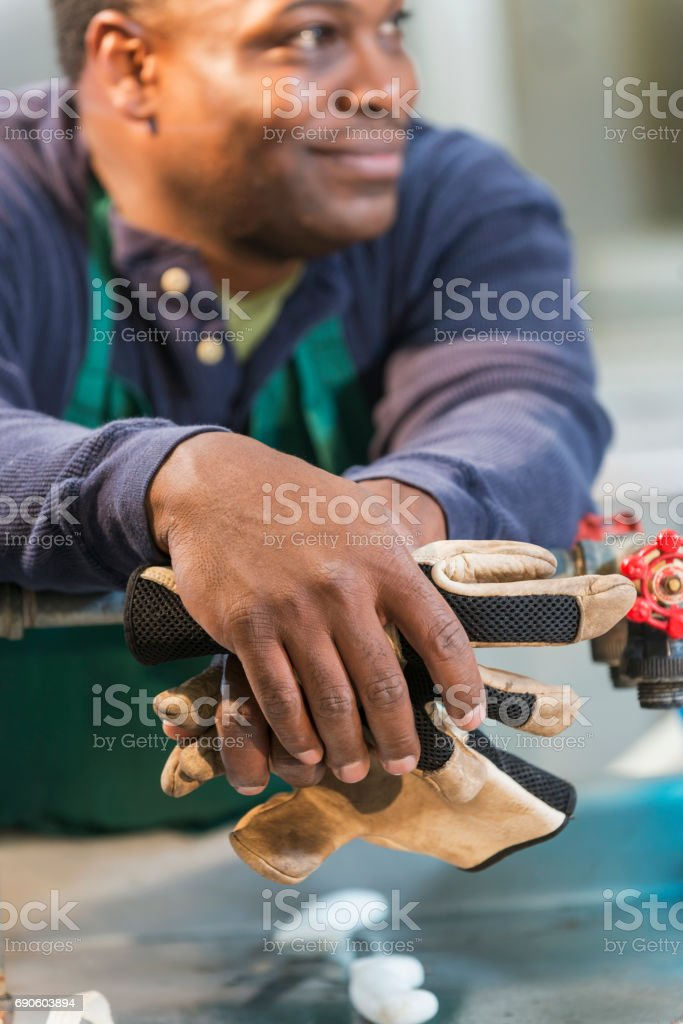 Black man working in a food processing plant stock photo