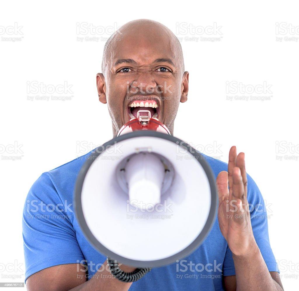 Black man yelling through a loudspeaker stock photo