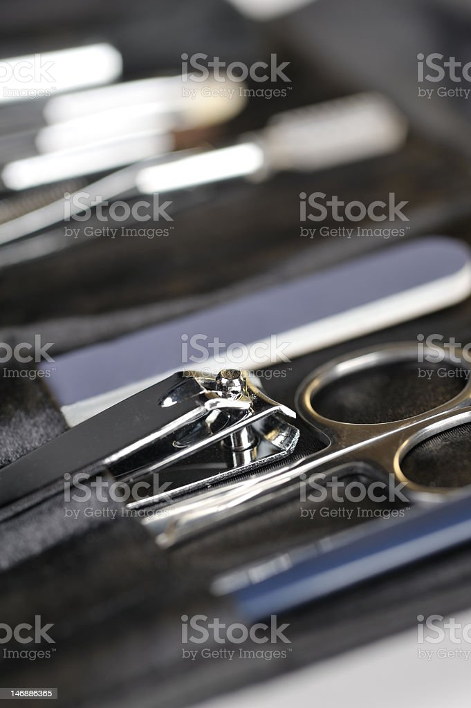 black manicure set, scissors ans nail clipper are in foreground stock photo