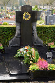 Black Marble tombstones in French cemetery
