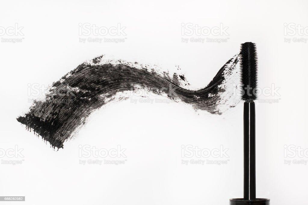 Black mascara. Brush and smear of carcass stock photo