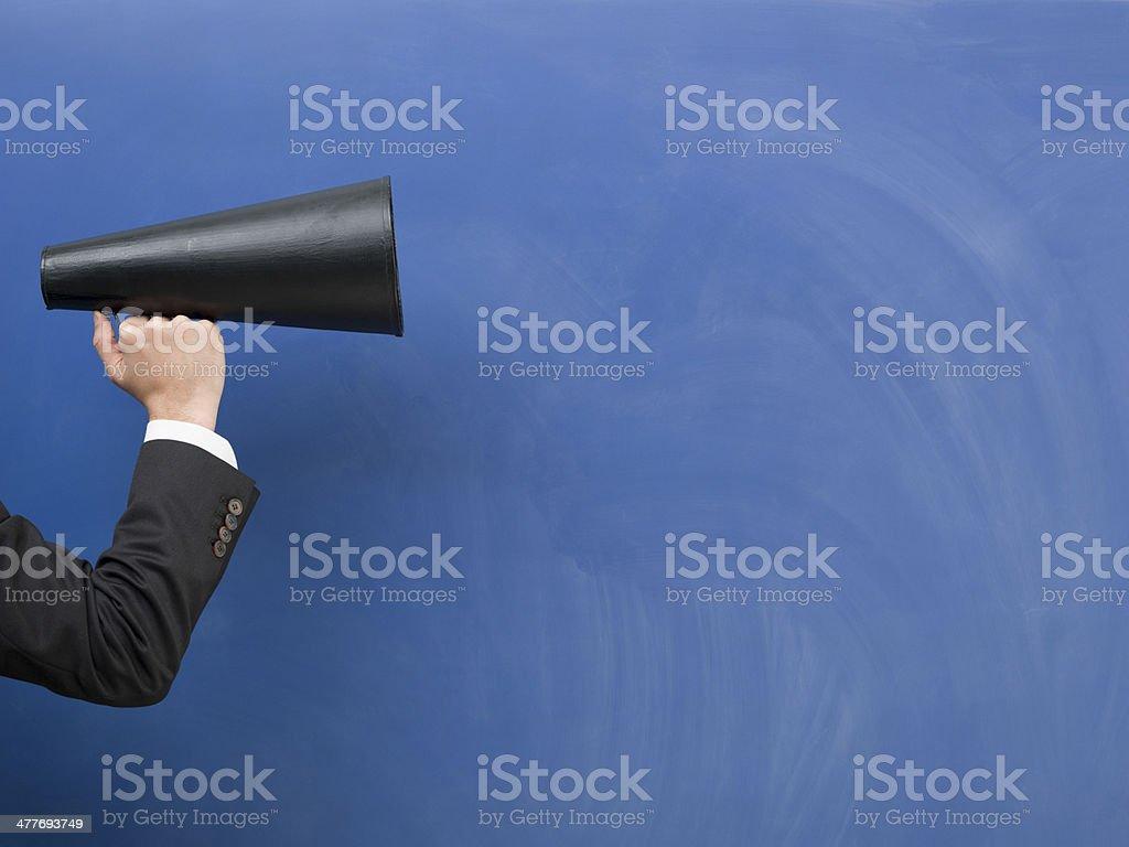 Black megaphone on blue blank blackboard stock photo