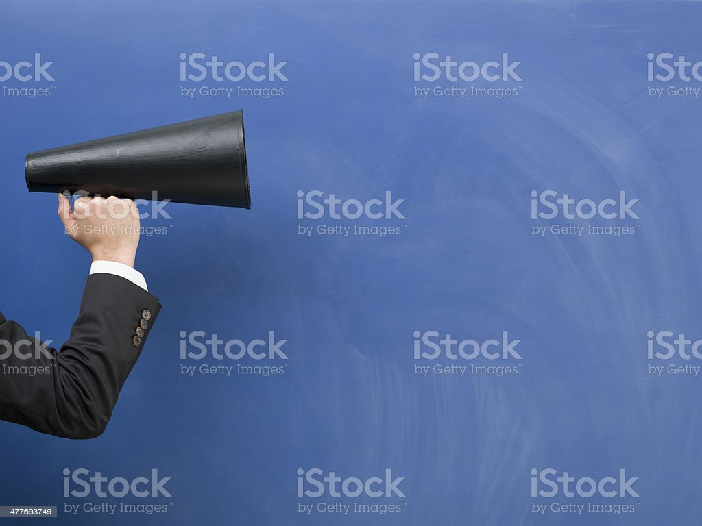 Black megaphone on blue blank blackboard stock photo