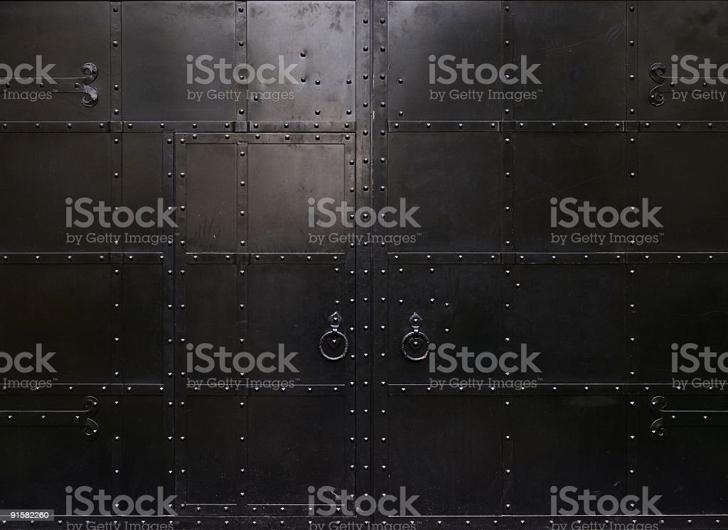 Black metal door with square linings stock photo
