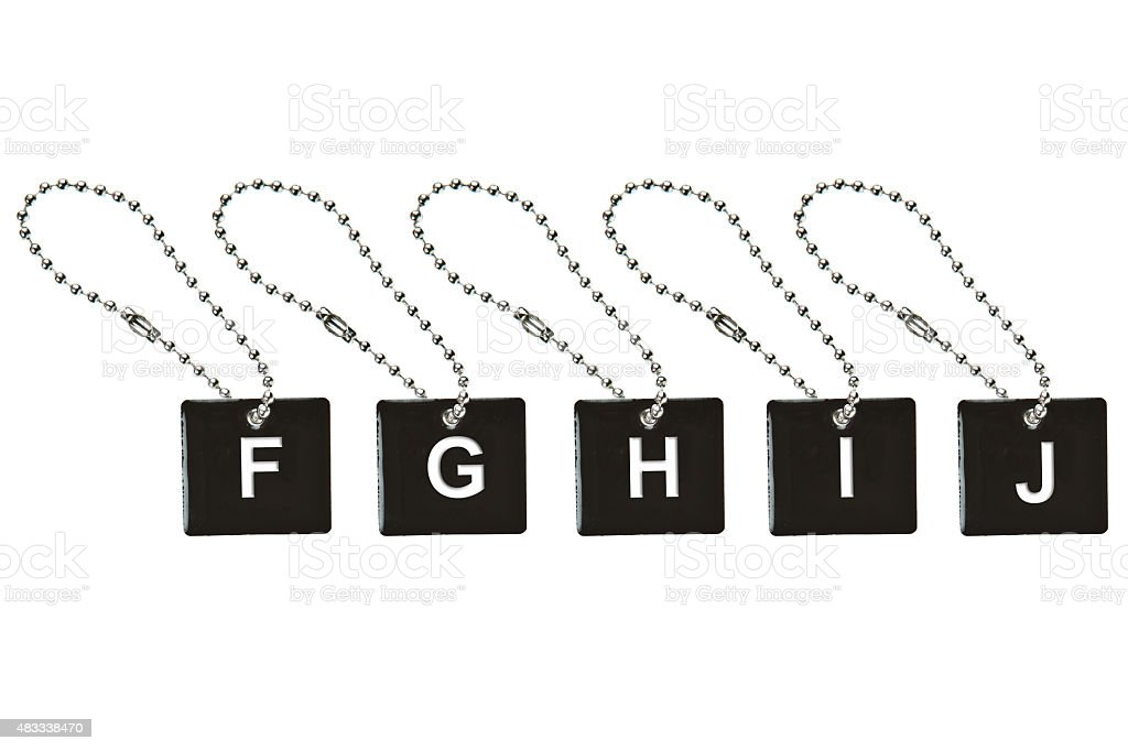 Black metal key tag with letter F-J stock photo
