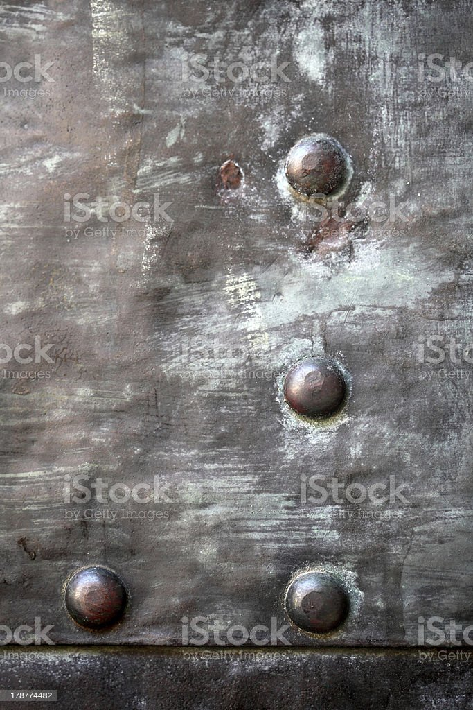 Black metal plate or armour texture with rivets stock photo