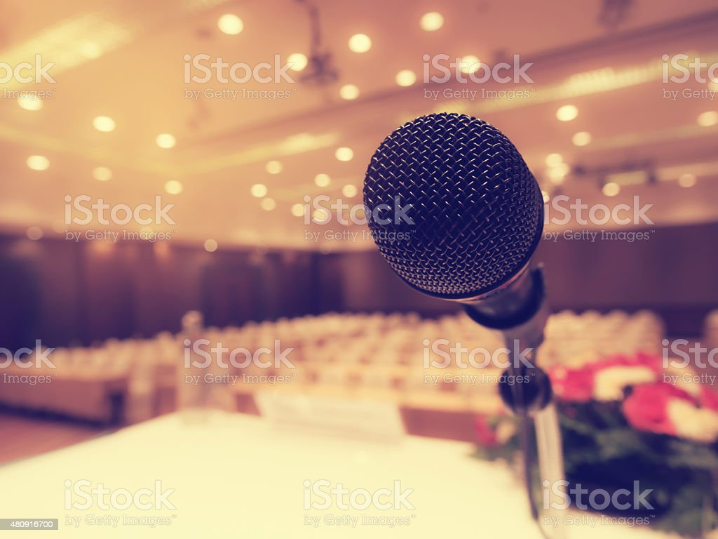 Black microphone in concert hall or conference room. stock photo