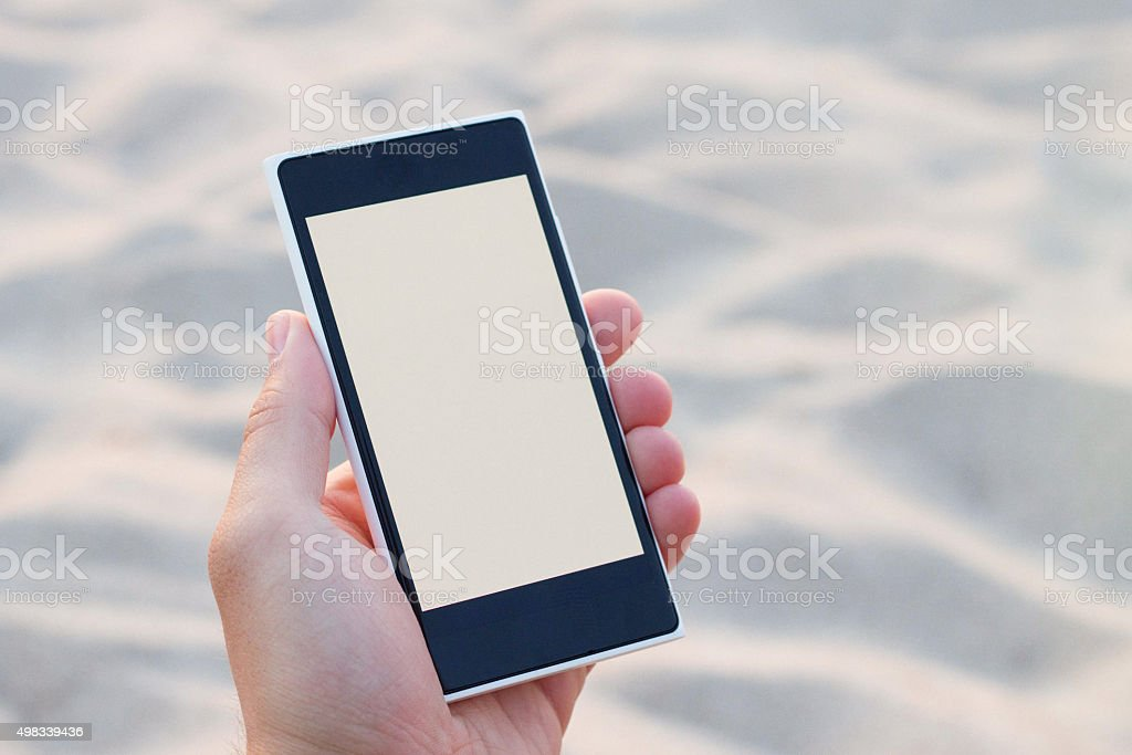 Black mobile phone in hand with a blank space stock photo