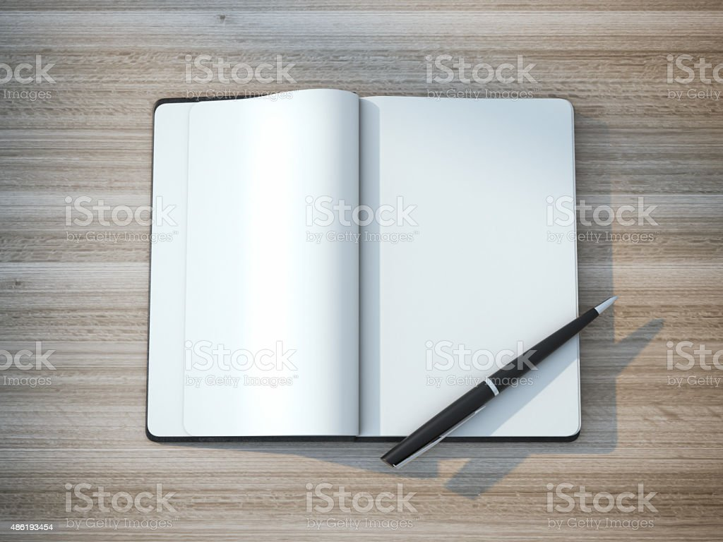 Black moleskin with a nice expensive pen stock photo