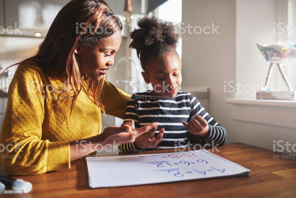 Black mom and child doing homework stock photo