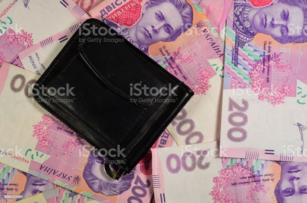Black money clip on a background of the ukrainian banknotes stock photo