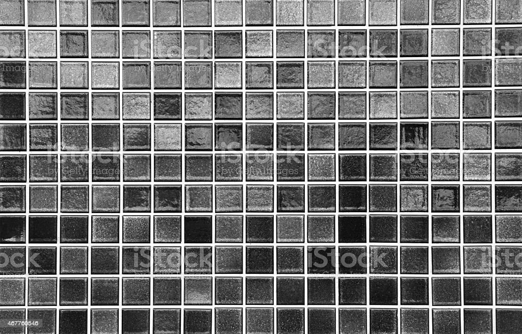 Black mosaic tile wall seamless background and texture stock photo