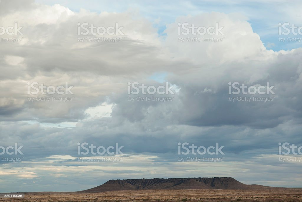 Black mountain showing folded strata. Namibia stock photo