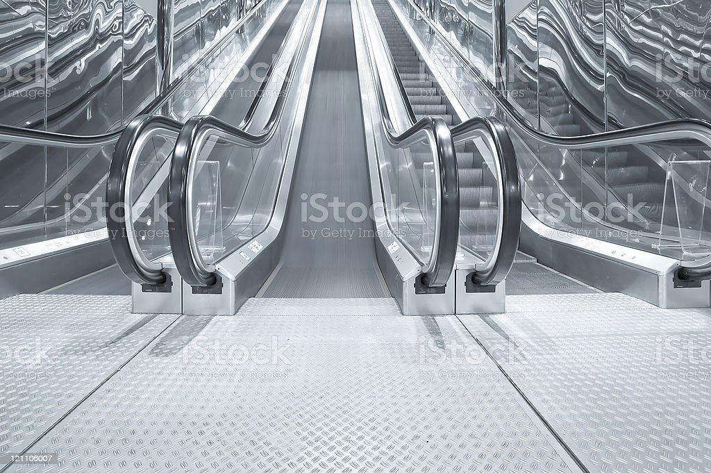 black moving escalator stairs inside business blue hall royalty-free stock photo