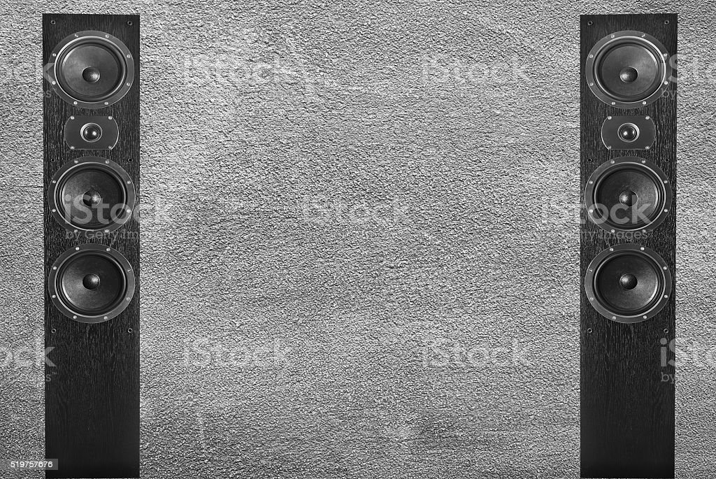 Black music speakers in gray wall backgrond stock photo