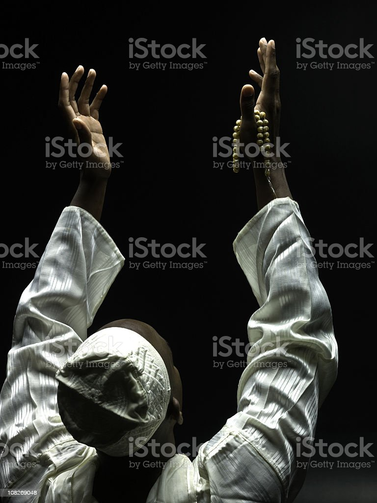 Black muslim man praying stock photo