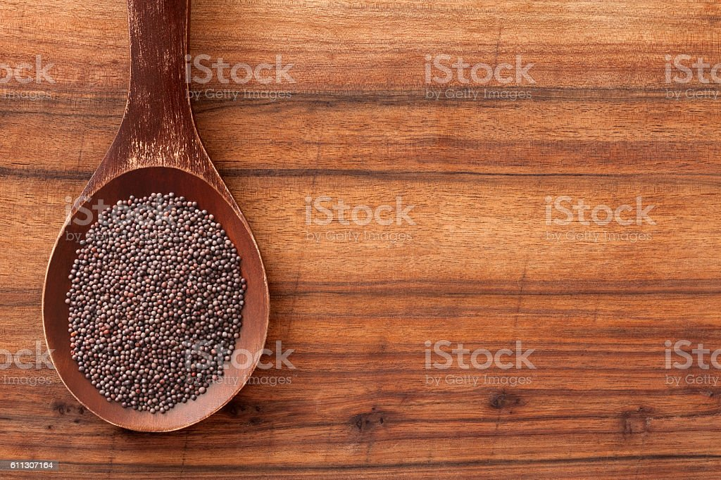 Black mustard seeds stock photo