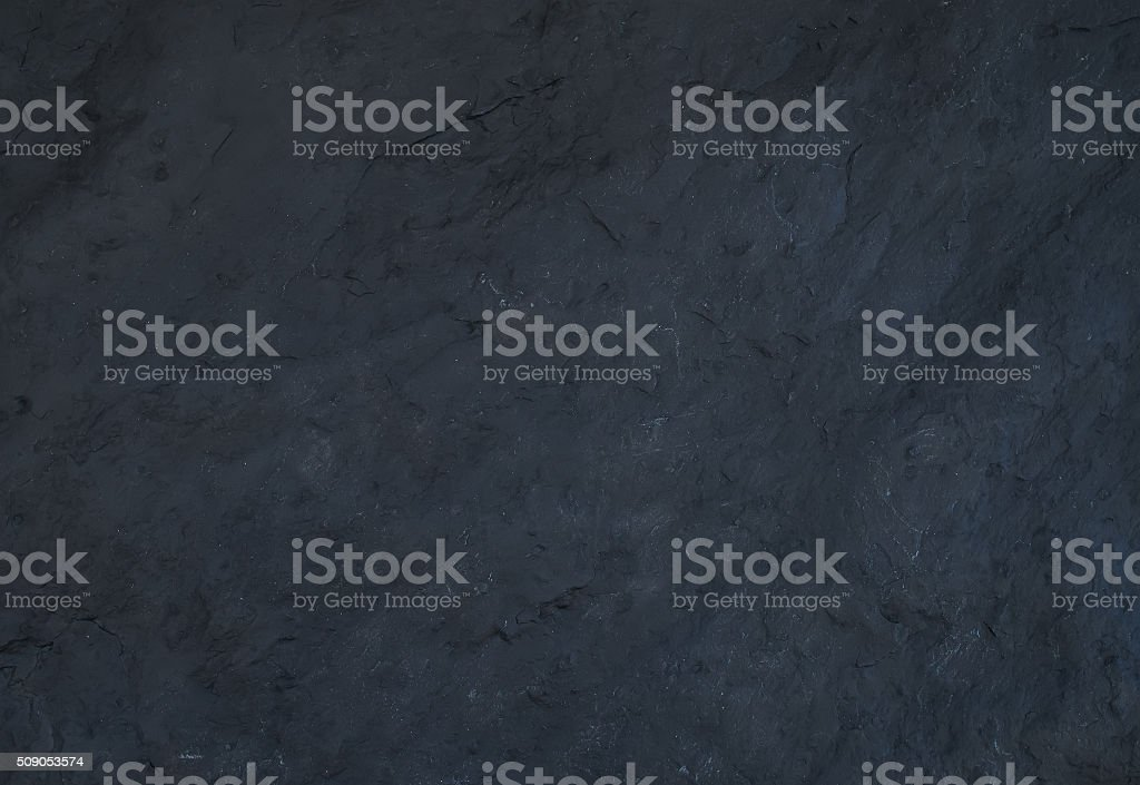 Black natural slate stone texture or background stock photo