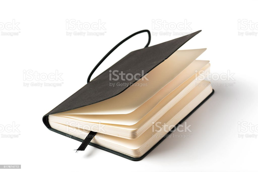 Black note book isolated on white background. stock photo