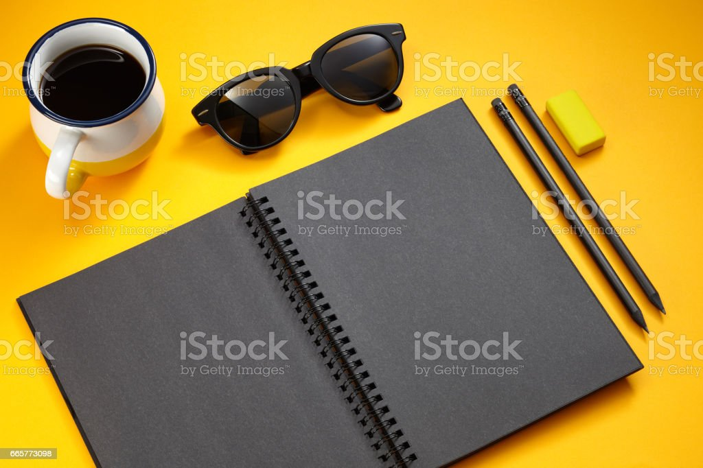 black notebook on the yellow background stock photo