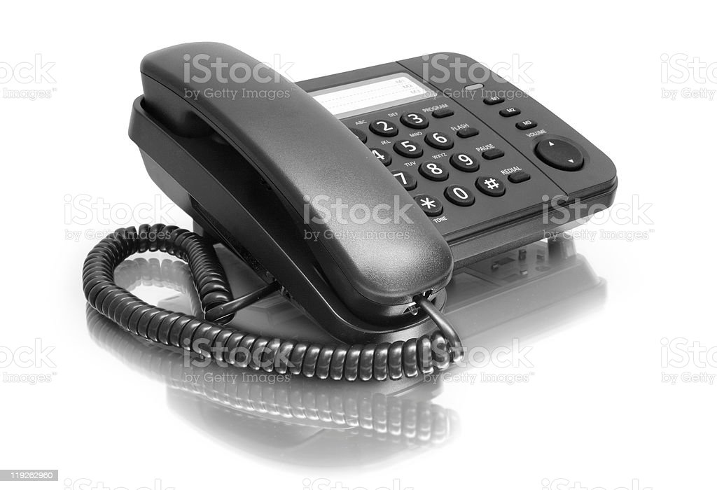 A black office phone on a white background stock photo