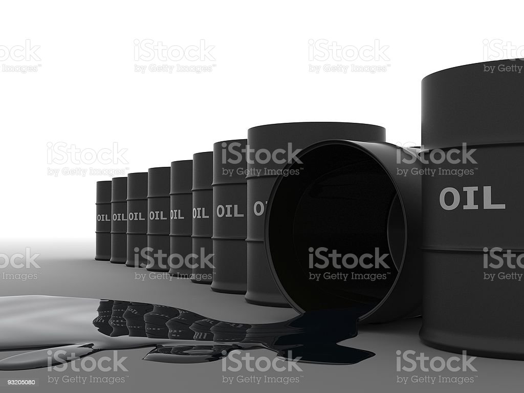 Black oil barrels lined up with one tipped over spilling oil stock photo