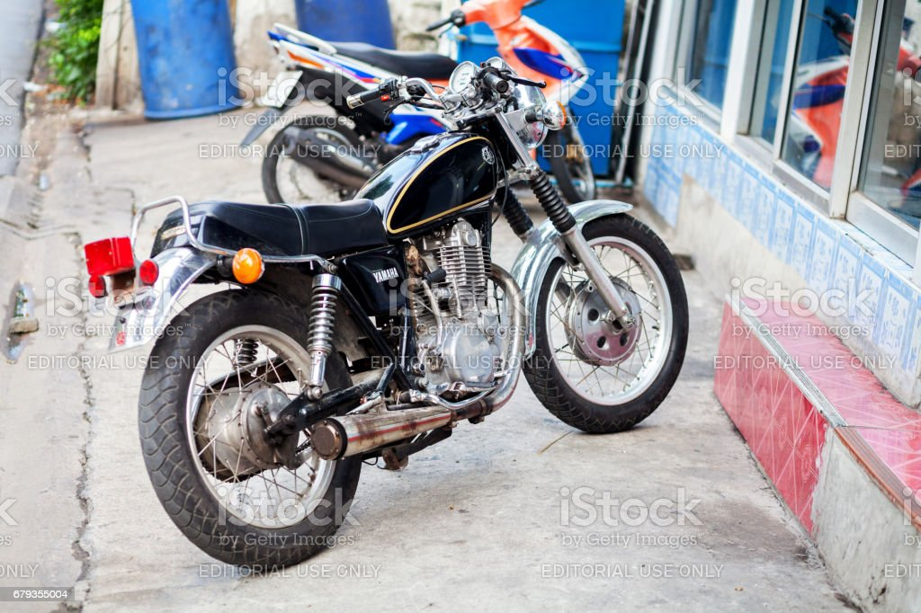 Black old Yamaha motorcycle stock photo