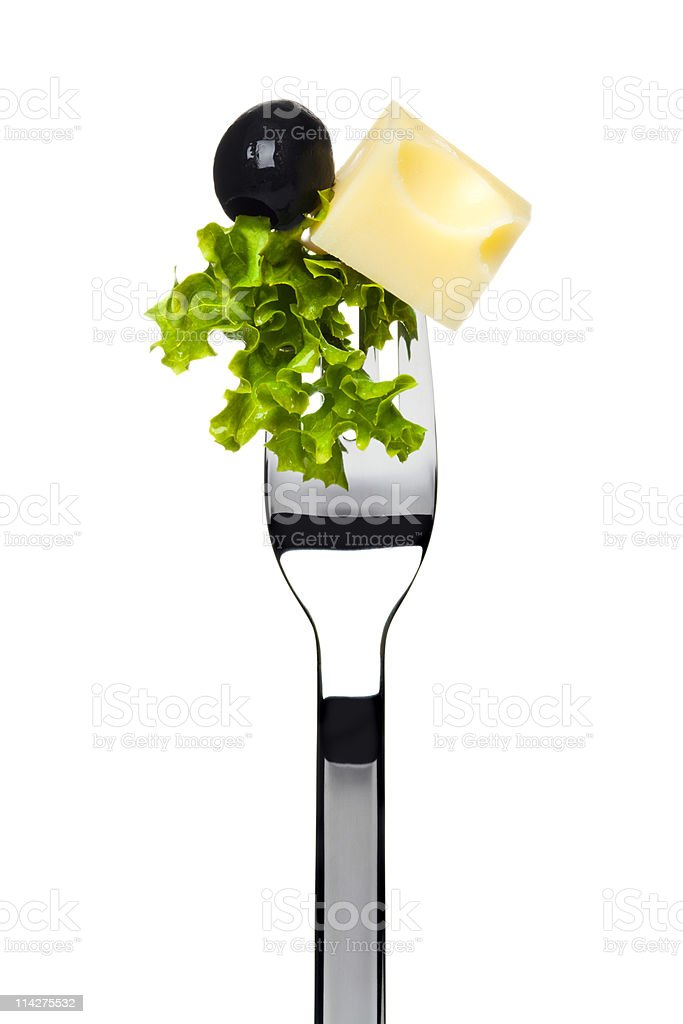 black olive, cheese and lettuce sticking on fork royalty-free stock photo