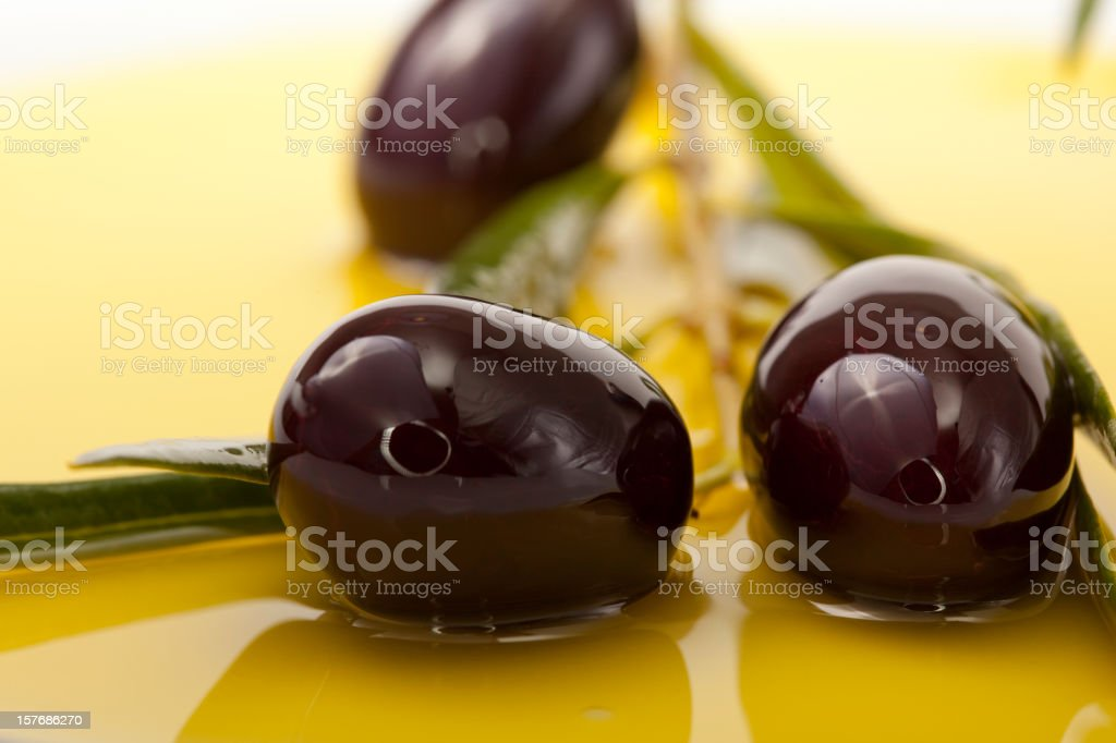 Black Olives in olive oil background stock photo