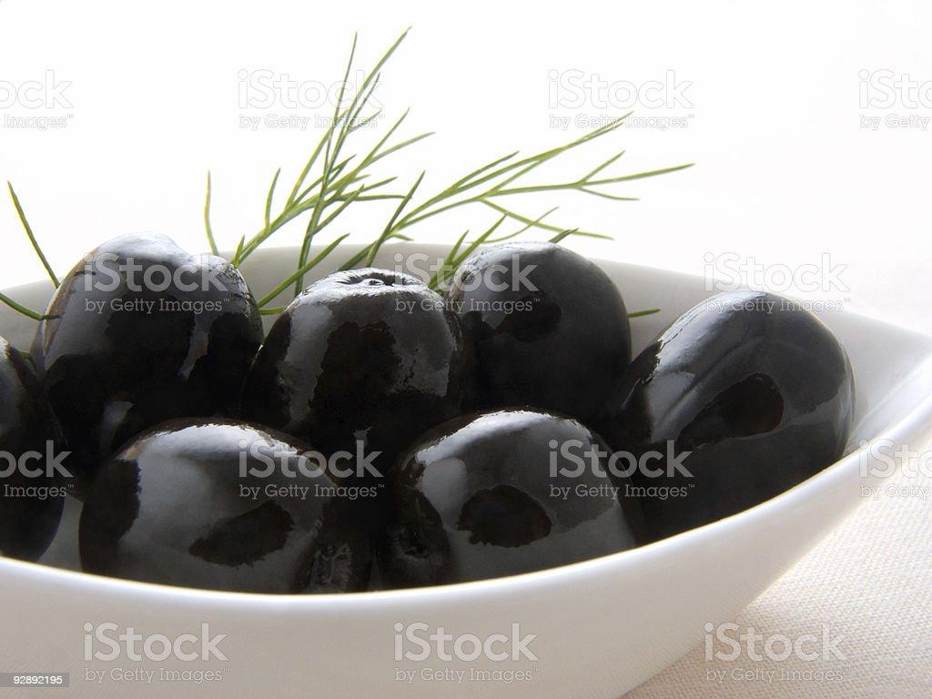 Black olives in the white bowl stock photo