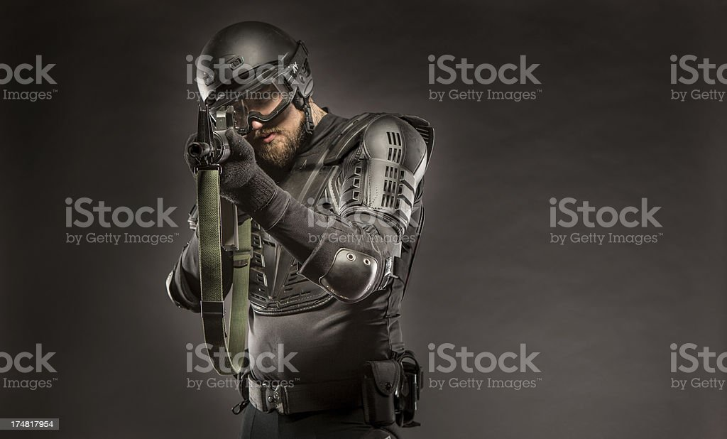 Black Ops Military Soldier Aiming Assault Rifle at Enemy royalty-free stock photo