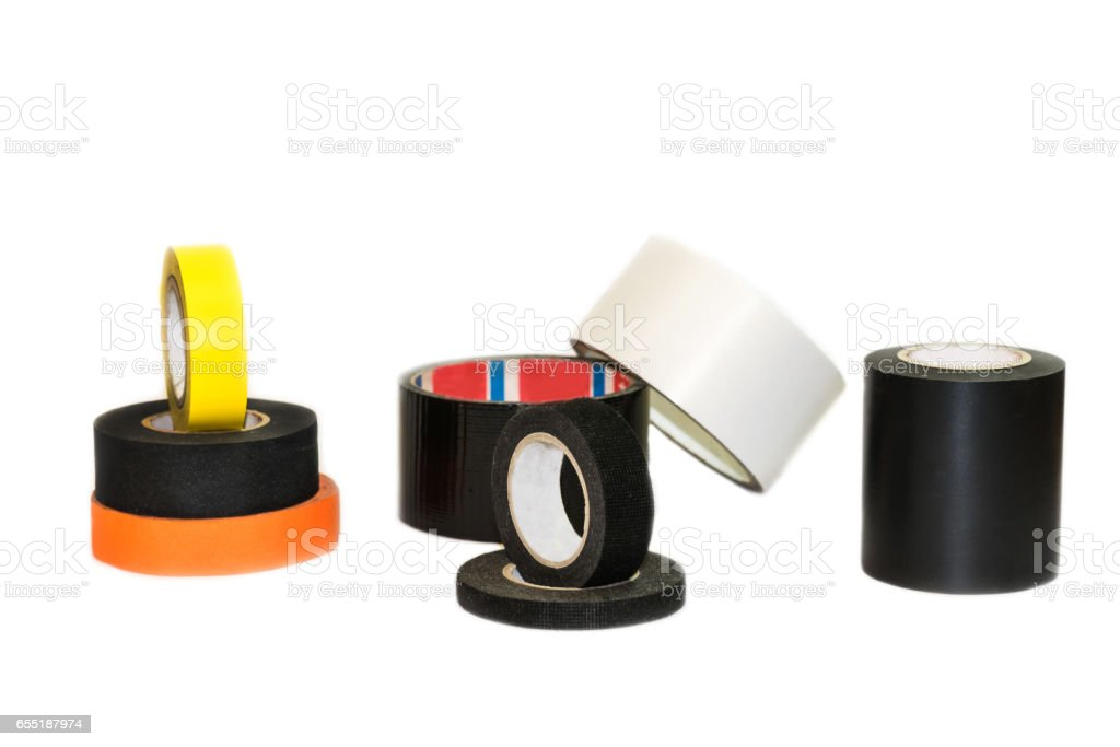 Black, orange and yellow insulation tape hank, isolated on a white background stock photo