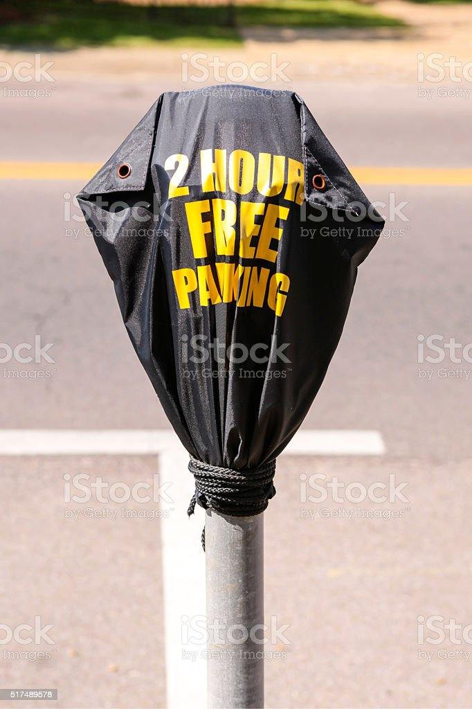 Black Out of use parking meter cover stock photo