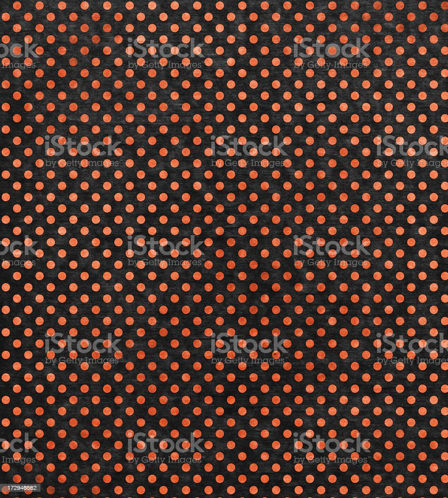 black paper with orange dots stock photo
