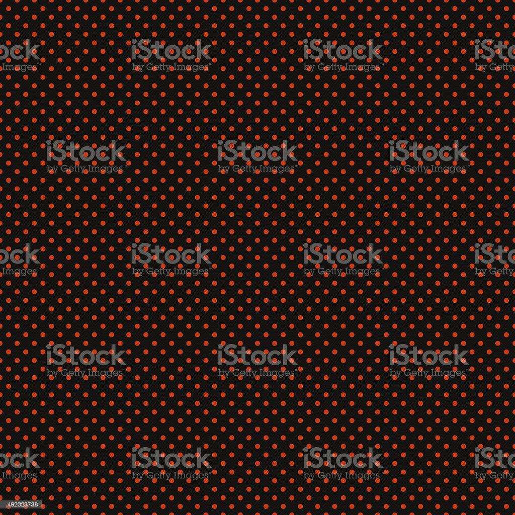 Black paper with orange glitter dots stock photo