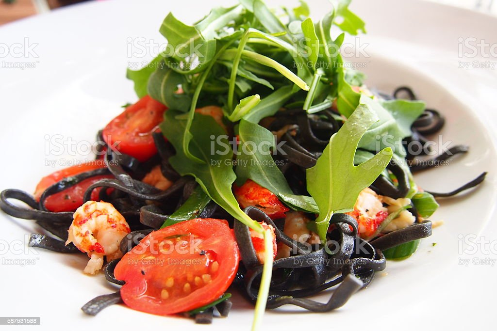Black Pasta with tomato and shrimp royalty-free stock photo