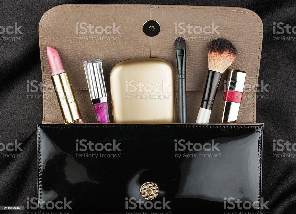 Black patent leather bag  with cosmetics stock photo