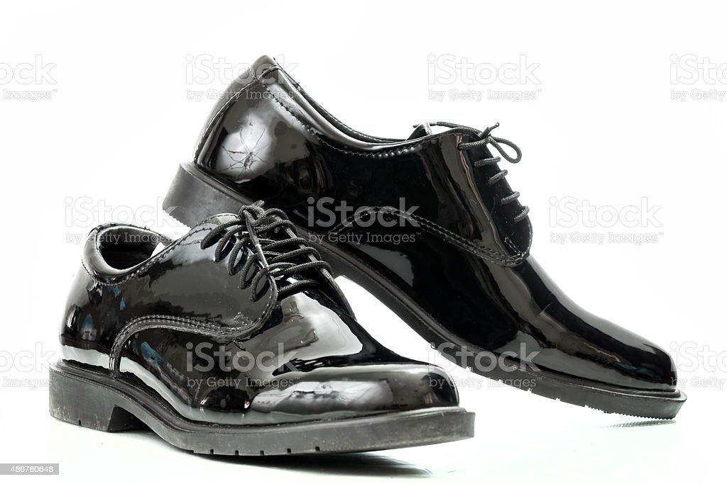Black patent leather men shoes army  isolated stock photo