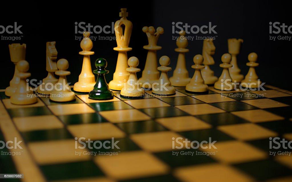 Black pawn play for white chess stock photo
