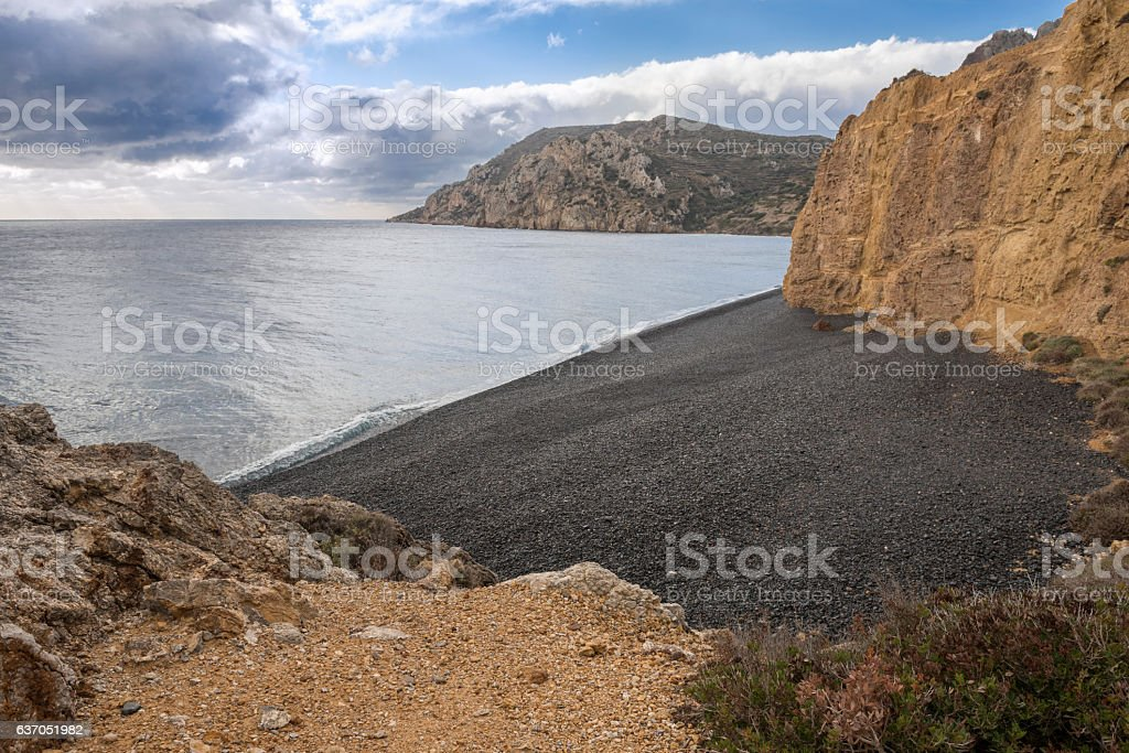 Black pebbles beach on Greek Island of Chios stock photo