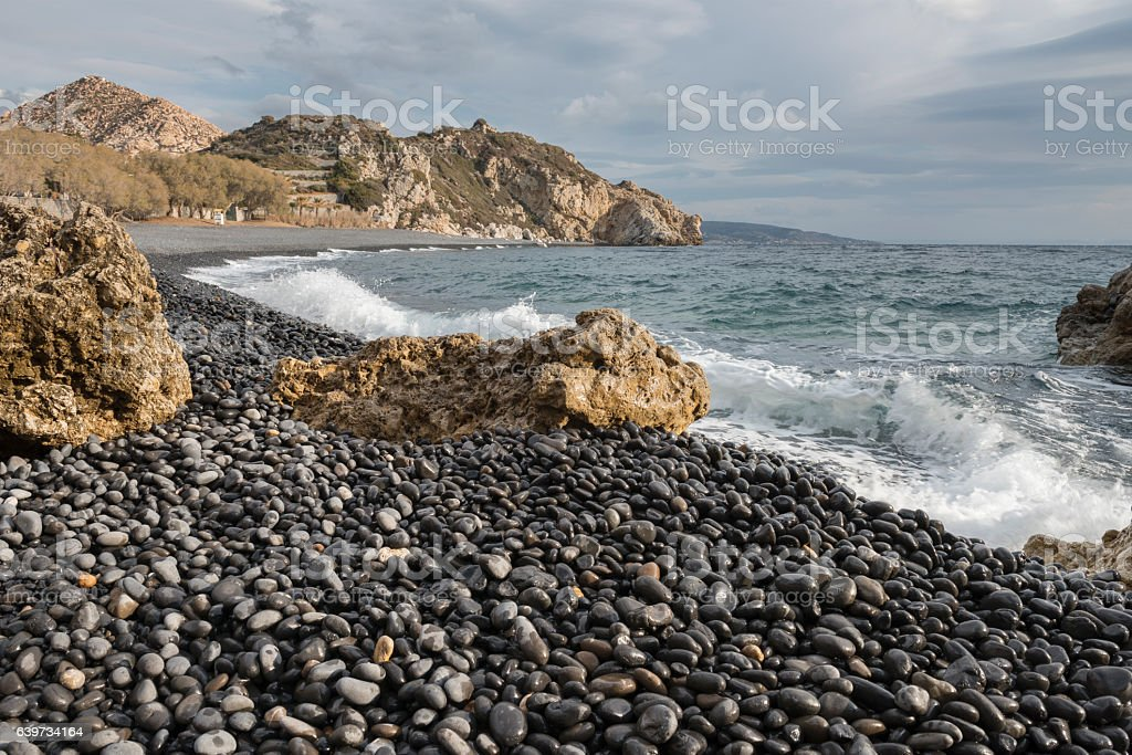 Black pebbles beach on Greek Island of Chios stock photo