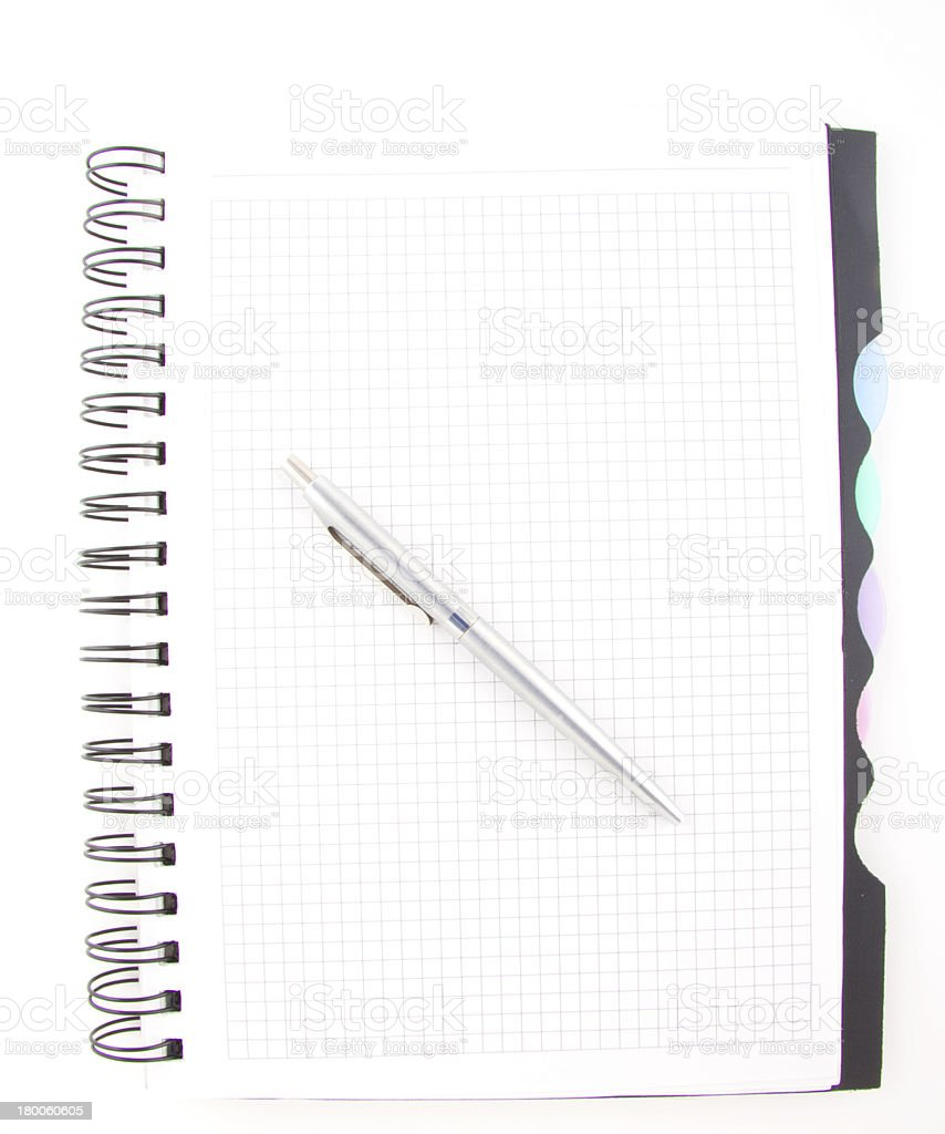 black pen and notebook isolated royalty-free stock photo