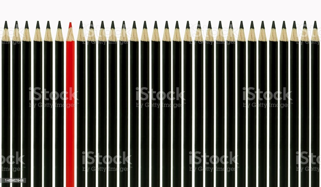 black pencils in line with one red standout royalty-free stock photo