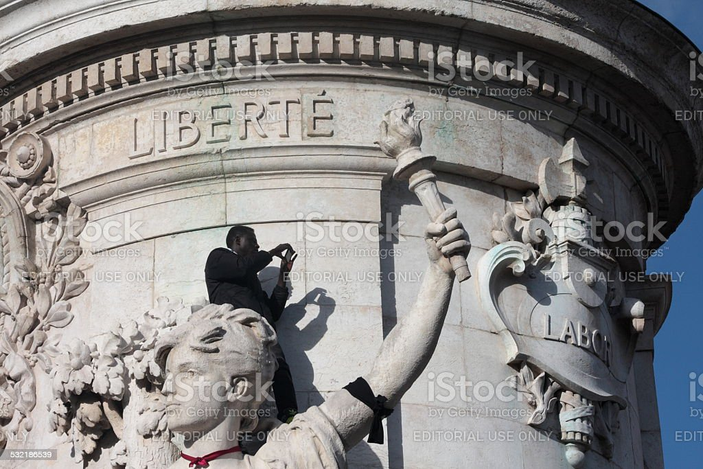 Black people on statue of republic in Paris stock photo